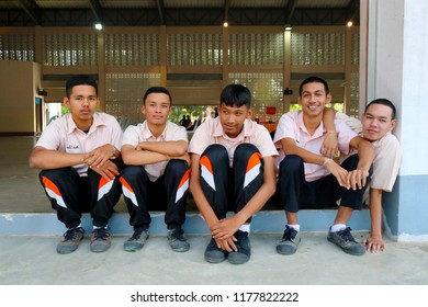 Photo of Thai students in uniform are sitting together at the gym of Paknampran school, Paknampran, Pranburi, Thailand December 3, 2018