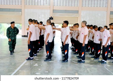 Photo of Thai teenage students are lining up in the order of a soldier for the discipline practice at Paknampran school, Paknampran, Pranburi, Thailand December 3, 2018