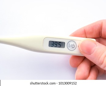 Photo of thermometer in hand.