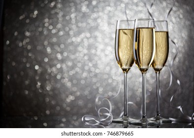 Photo of three glasses with wine on gray background