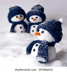 Photo of three hand made snowman in blue color - optimal decoration for christmas, new year, winter scenery