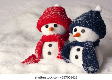 Photo of three hand made snowman in blue color and red - optimal decoration for christmas, new year, winter scenery