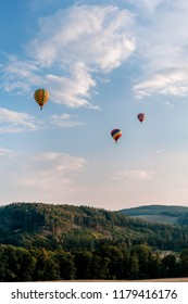 Photo of three hot air balloons on the sky at the festival in Bouzov.