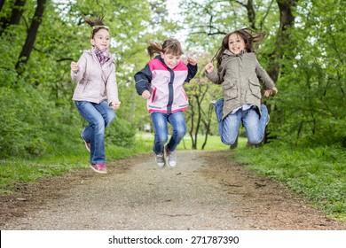 Photo of three little girls jumping
