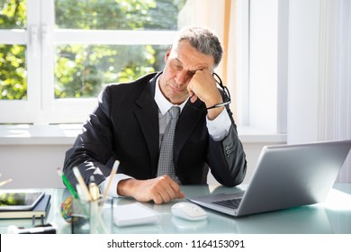 Photo Of Tired Mature Businessman Sleeping In Office