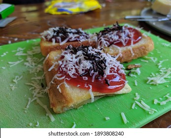 photo of toast bread topped with strawberry jam, cheese and chocolate sprinkles