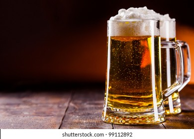 photo of traditional german beer glass on wooden table