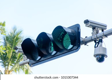 photo of traffic light and cctv camera
