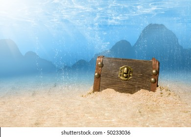 photo of treasure chest submerged underwater with light rays