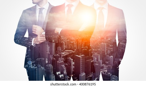Photo of trio stylish adult businessman wearing trendy suit. Double exposure, panoramic view sunset contemporary city background. Man power, leadership, isolated on white. Horizontal