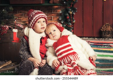 Photo of two beautiful children playing in a Christmas garden