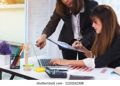 Photo of two confident business woman working looking at laptop monitor for startup new project at office. Achieving best results of teamwork.