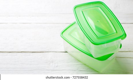Photo of two containers with green lid