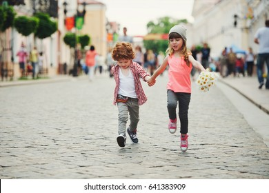photo of two cute little hipsters running away