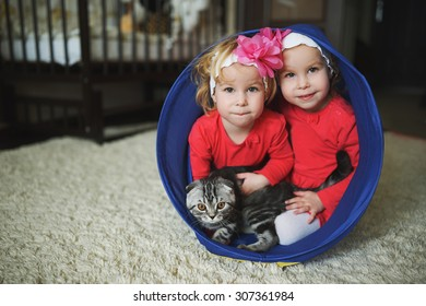 photo of two cute twin girls portrait
