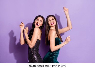 Photo of two excited classy ladies dance back-to-back wear fancy dresses isolated violet color background