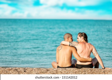 photo of two men in love hugging each other in front of the sea