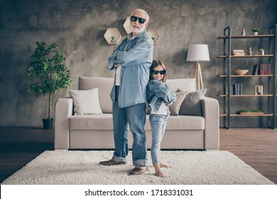 Photo of two people funky grandpa small nice granddaughter cool stylish trendy sun specs denim clothes confident best friends carnival house party stay home quarantine living room indoors