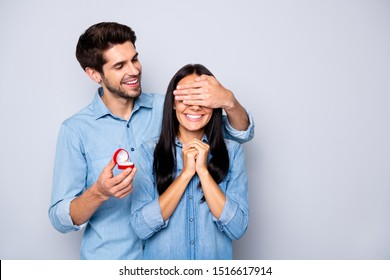 Photo of two people together white wearing jeans denim with girlfriend anticipating eyes covered and loving boyfriend getting ready to propose to her isolated grey color background
