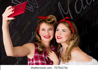 photo of Two pin-up girlfriends do selfie