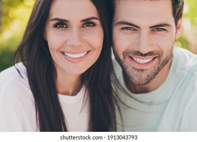Photo of two positive people romantic couple cuddle shiny white smile wear casual clothes in garden park outside