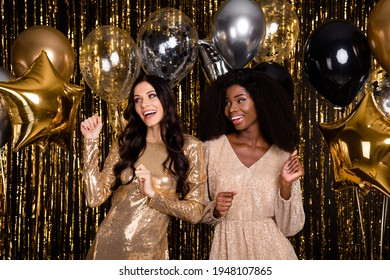 Photo of two stunning girls dance prom balloons funky wear dress isolated on shine tinsel background