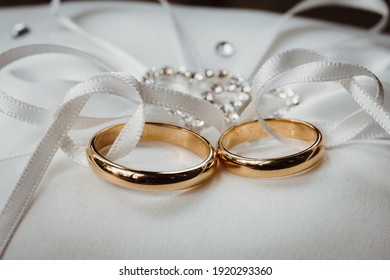 photo of two wedding rings in a ribbon