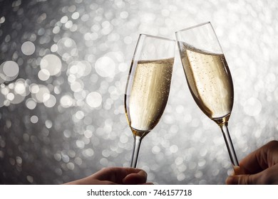 Photo of two wine glasses with wine on gray background