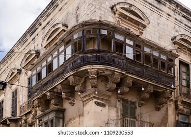 Photo of Typical maltese balcony, street of Valletta, Malta