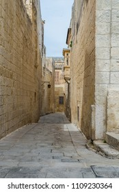 Photo of Typical street of Malta, ancient buildings and architecture