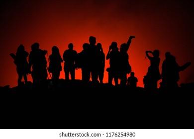 Photo of unrecognized tourists' silhouettes on Erta Ale Volcano edge illuminated with lava. Danakil Depression, Ethiopia, East Africa
