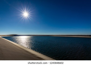 Photo of the upper water reservoire Dlouhe Strane in the Jeseniky mountains in Czech Republic with dark blue sky and sun