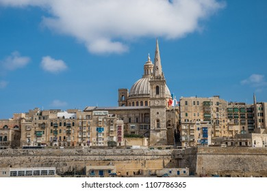 photo of Valletta, Malta, skyline of capitol city with blue sky and clouds as background