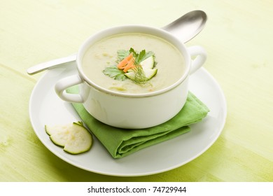 photo of vegetarian vegetable soup on green wooden table