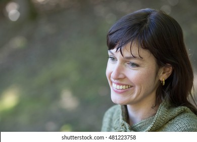 Photo of a very attractive 30-year-old woman with brown hair and eyes.