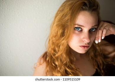 Photo of a very attractive redhead looking at the camera.