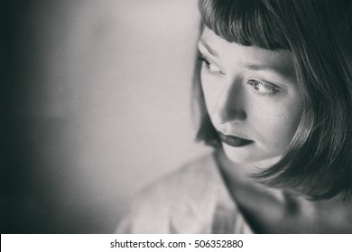 Photo of a very attractive young woman processed to look like a vintage black and white photo.