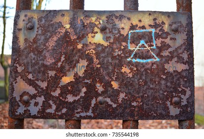 photo of a very rusty old sign