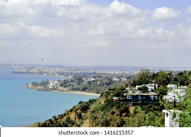 Photo from viewpoint over the gulf of Tunis taken from Sidi Bou Said the blue city it shows the mediterranean sea of Tunis, Tunisia on the coast you see La Goulette La Kram and Carthago.