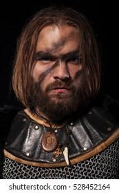 Photo of viking warrior on a black background.