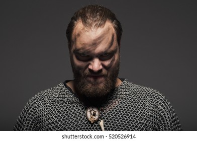 Photo of viking warrior on a gray background.