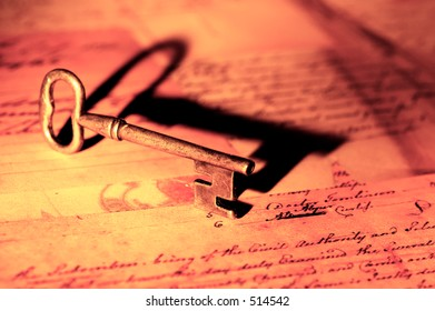 Photo of a Vintage Key and Letters.