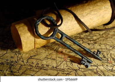 Photo of Vintage Maps and a Tresure Chest Key - Exploration Concept
