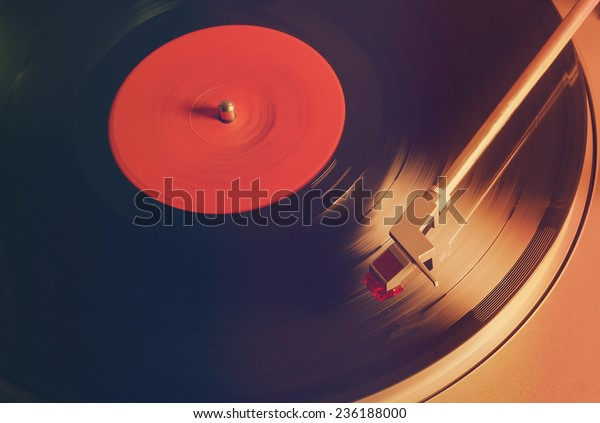photo of Vintage vinyl record with red label, retro film filtered, instagram style