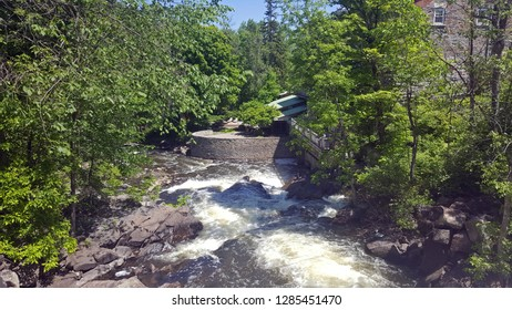 A photo of The Wakefield Mill rapids behind the Mill.