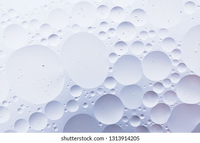 Photo of Water oil bubble macro abstract background flow liquid blue white aqua colors