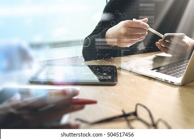 Photo website graphic designer hand meeting team with new project modern studio.laptop digital tablet smart phone on marble table.Books papers documents, sun flare effect
