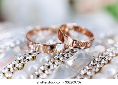 Photo of wedding rings in gold closeup