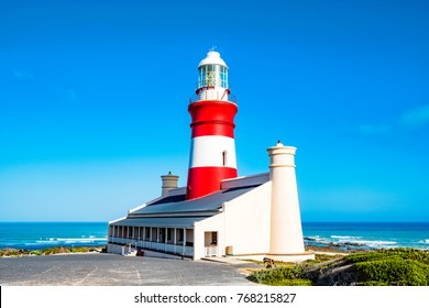 Photo of the western cape lighthouse at the Agulhas national park, the southernmost point of Africa, where the atlantic ocean and the indian oceans meet.