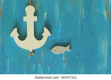 Photo of white anchor on wooden background